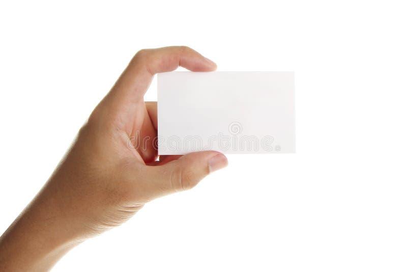 Mano con la tarjeta de visita en blanco foto de archivo libre de regalías