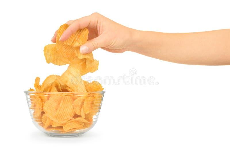 Mano con le patatine fritte e la ciotola immagini stock