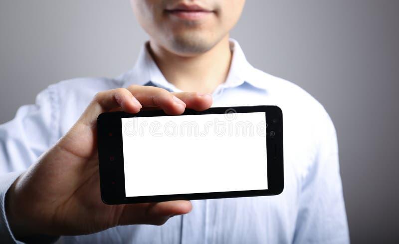 Mano con lo Smart Phone in bianco immagini stock libere da diritti