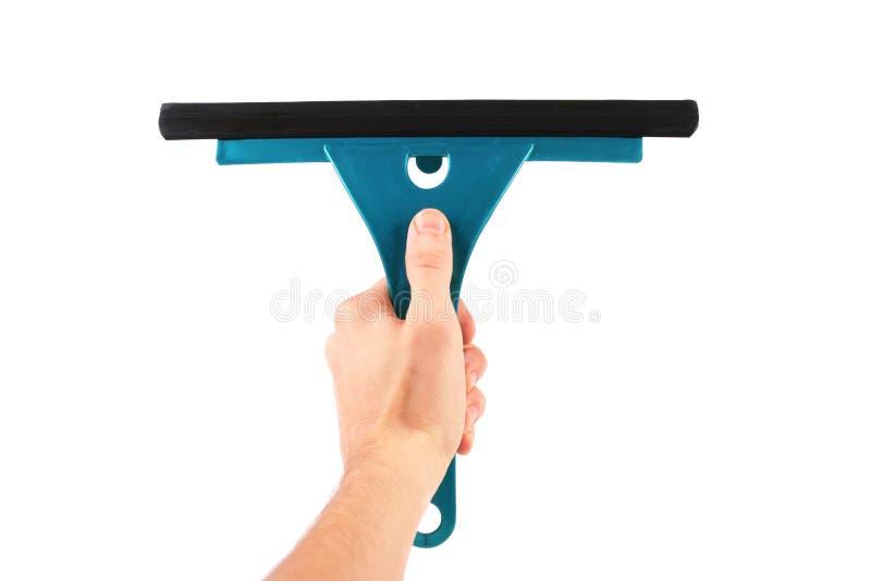 Mano con lo strumento di pulizia di finestra fotografia stock libera da diritti