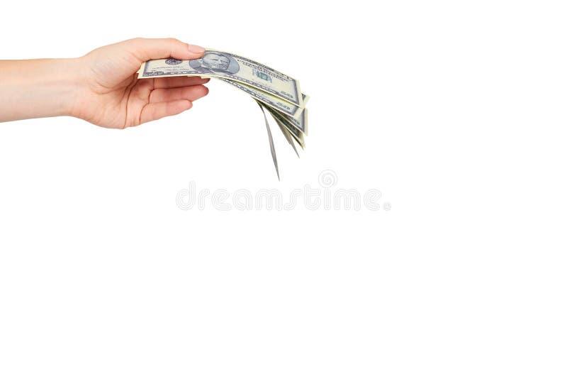 Mano con los d?lares americanos, el concepto de sobornos y la corrupci?n foto de archivo libre de regalías