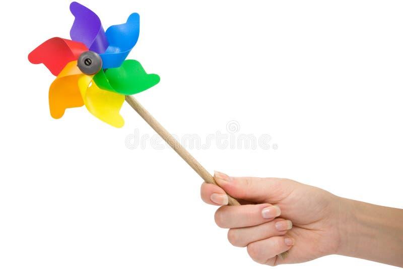 Mano con un pinwheel del color. imagen de archivo libre de regalías