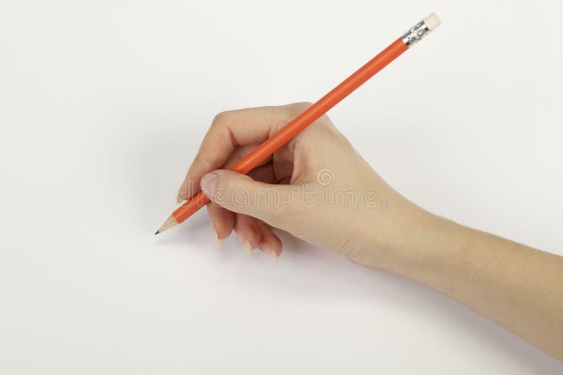 Mano con una matita fotografia stock