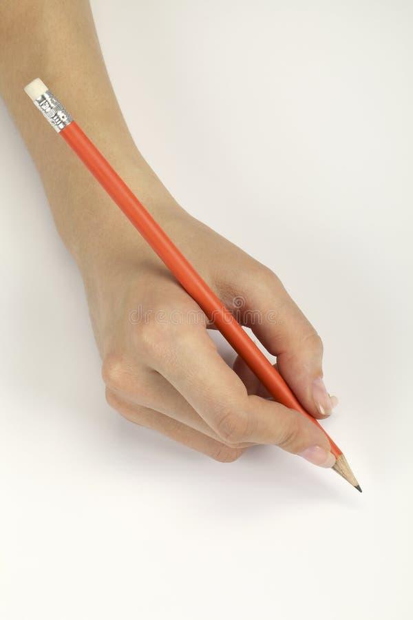 Mano con una matita immagini stock libere da diritti