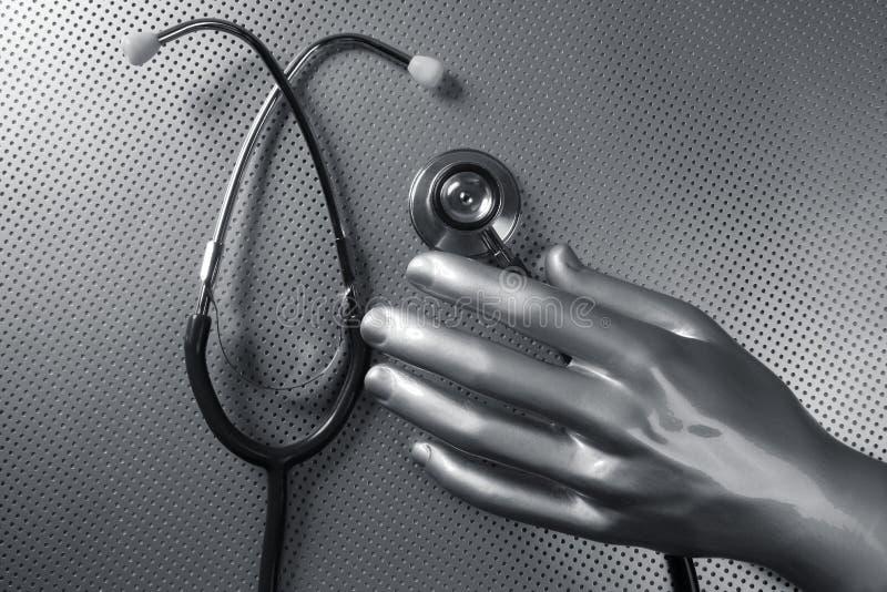Mano d'argento futuristica dello stetoscopio di salute fotografie stock libere da diritti