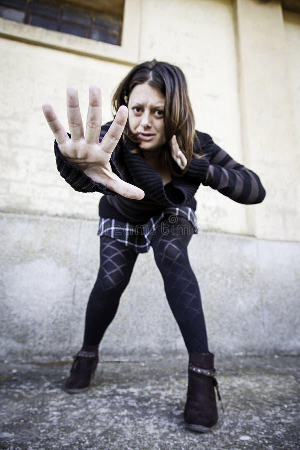 Mano d'attacco della donna fotografie stock