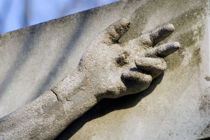 Mano de Cristo en piedra fotografía de archivo