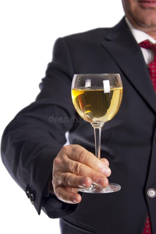 Mano de la explotación agrícola del vidrio de vino fotos de archivo