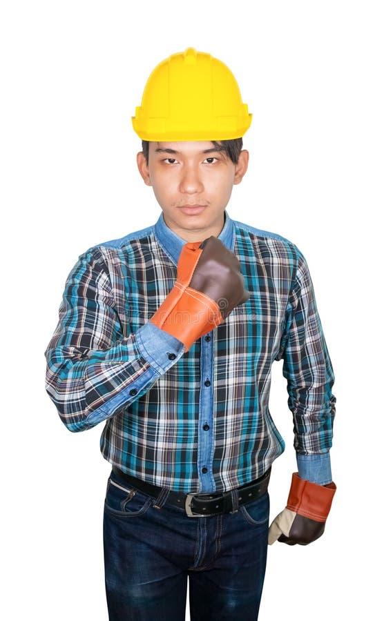 Mano de la ingenier?a con el pu?o que hace desgaste del s?mbolo el azul de la camisa rayada y el cuero del guante con el pl?stico fotos de archivo