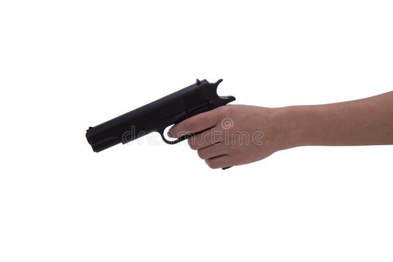 Mano de la mujer con el arma fotografía de archivo