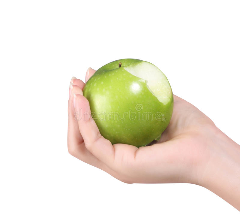 Mano de la mujer con la manzana verde aislada imagenes de archivo