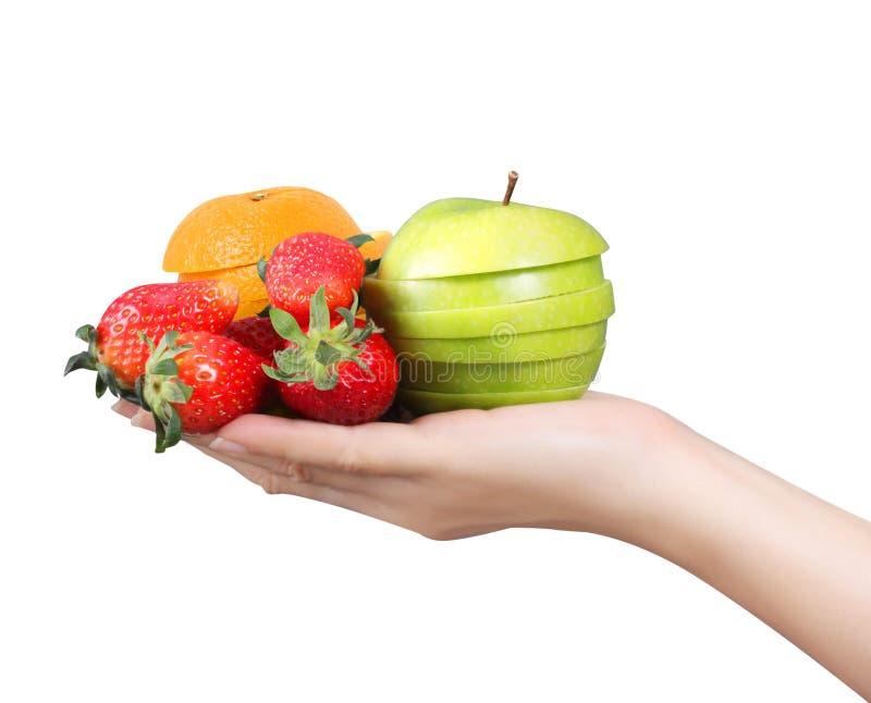 Mano de la mujer con las frutas fotos de archivo
