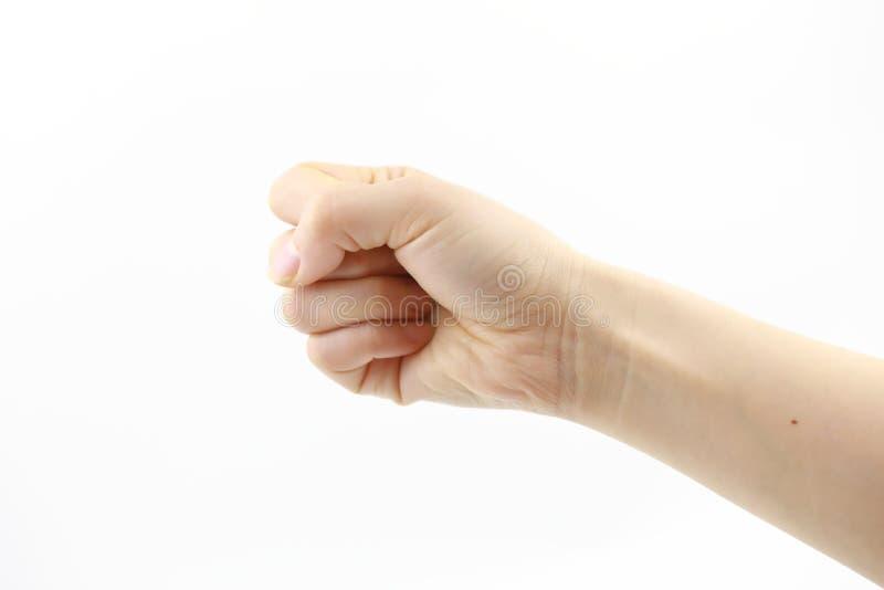 Mano de la mujer en el puño apretado del fondo blanco foto de archivo libre de regalías