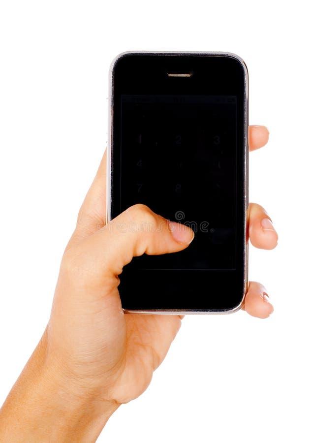 Mano de la mujer que sostiene el teléfono móvil fotos de archivo