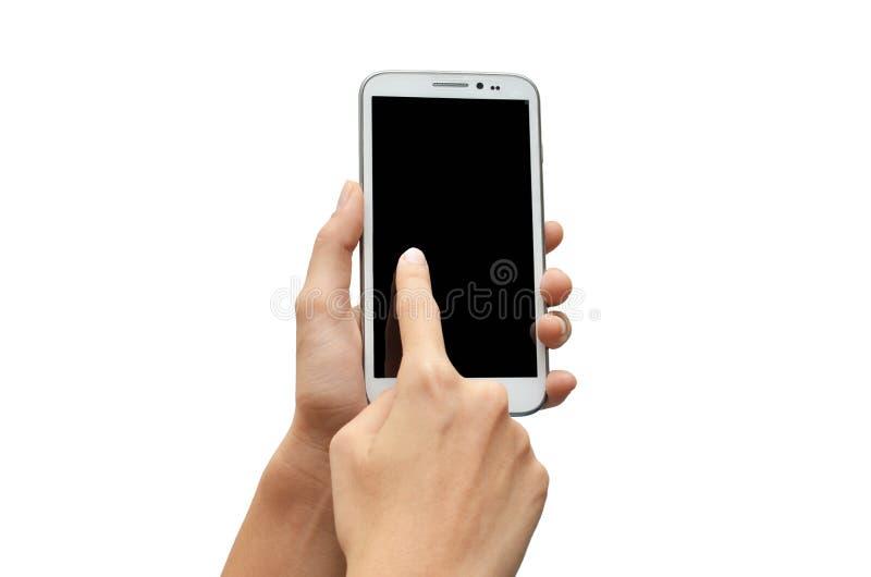 Mano de la mujer usando la pantalla táctil del teléfono móvil fotografía de archivo