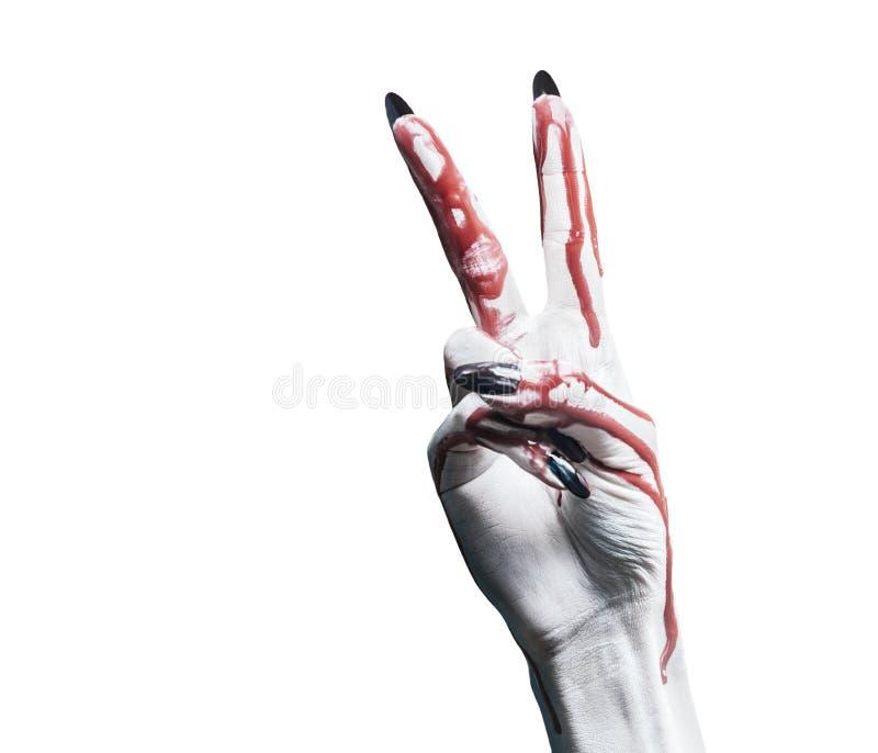 Mano de la sangre con el signo de la paz del gesto foto de archivo libre de regalías