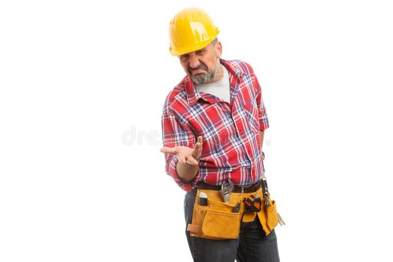 Mano de la tenencia del constructor como concepto dudoso fotos de archivo libres de regalías