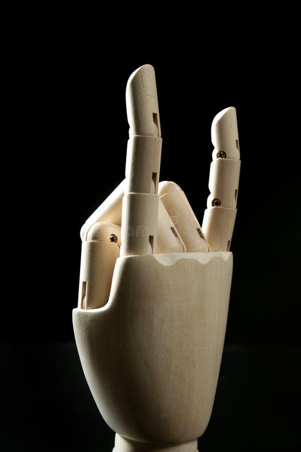 Mano de madera del maniquí, claxones con los dedos fotografía de archivo
