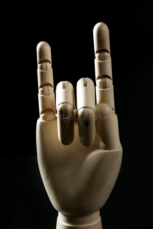 Mano de madera del maniquí, claxones con los dedos foto de archivo