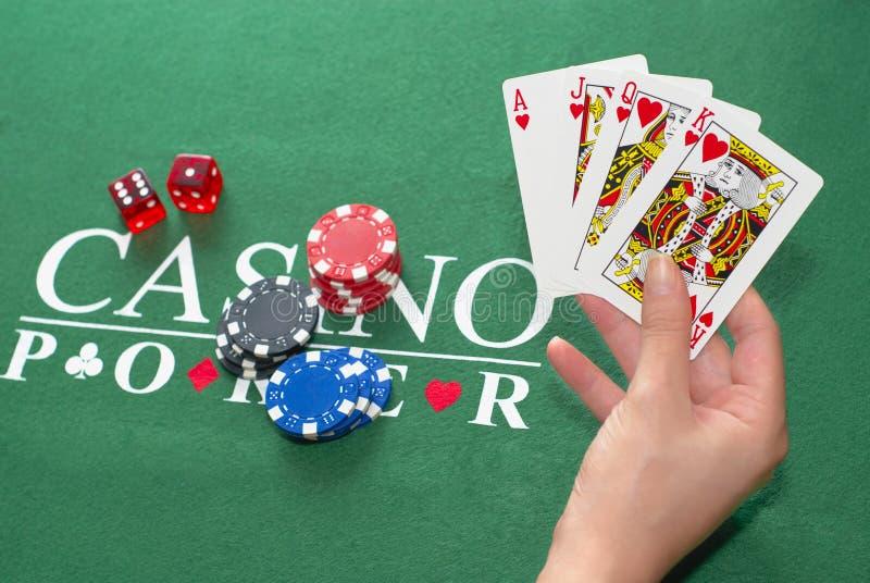 Mano de póker que gana fotografía de archivo libre de regalías