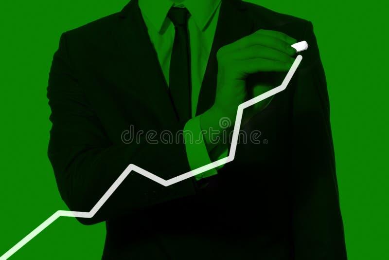 Mano de un diagrama del gráfico del hombre de negocios fotos de archivo