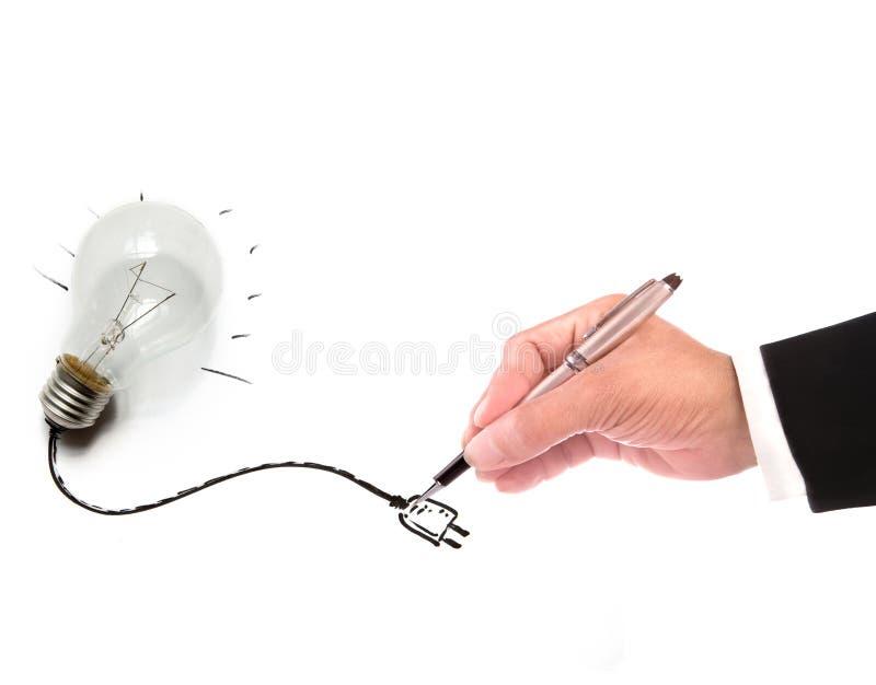 Mano del alambre de la escritura del hombre de negocios de la bombilla fotos de archivo libres de regalías