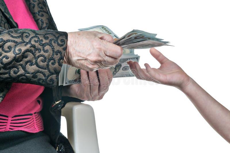 Mano del bambino che chiede soldi da sua nonna immagini stock