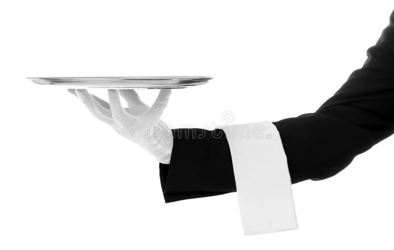 Mano del cameriere con il vassoio fotografie stock libere da diritti