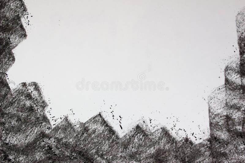 Mano del carbón de leña que dibuja el marco negro imagenes de archivo