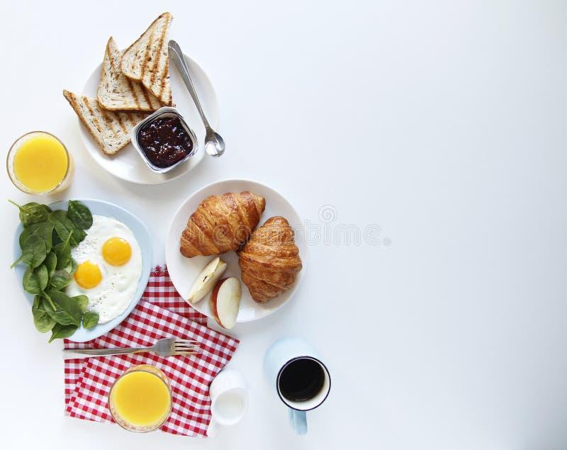 Mano del desayuno Visi?n superior Fondo ligero Copie el espacio fotografía de archivo