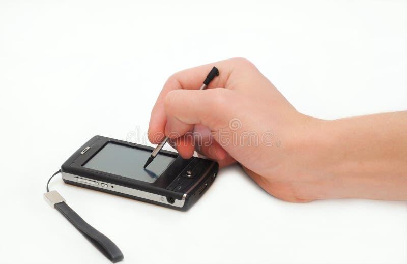 Mano del hombre con la PC del bolsillo aislada fotos de archivo libres de regalías