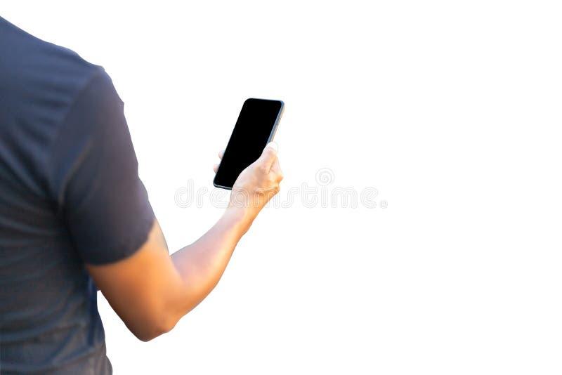 Mano del hombre que sostiene el teléfono móvil a disposición El teléfono móvil es pantalla negra Aislado en el fondo blanco Ahorr fotos de archivo libres de regalías