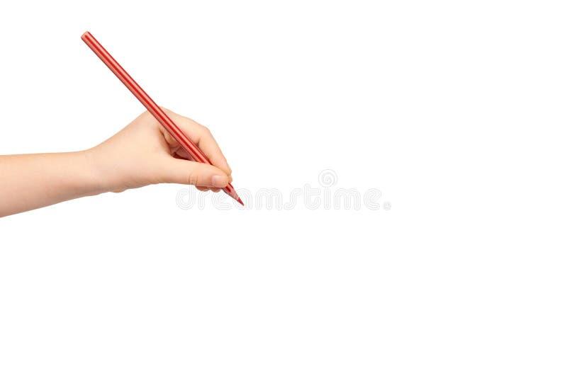 Mano del ni?o que sostiene el l?piz del color, escritura y dibujando gesto imagen de archivo libre de regalías