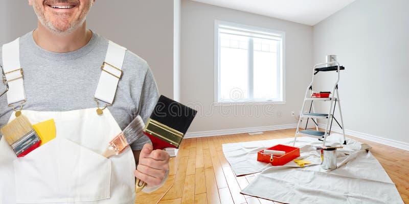 Mano del pintor con el cepillo de pintura imágenes de archivo libres de regalías