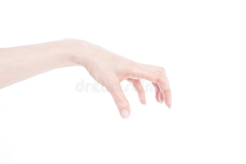 Mano del ` s della donna che fa gesto mentre gru a benna alcuni oggetti fotografia stock libera da diritti