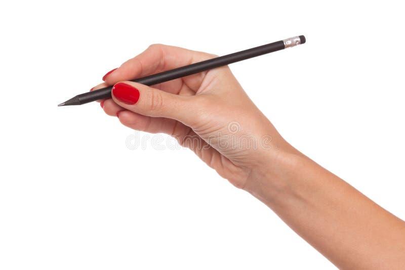 Mano del ` s della donna con i chiodi rossi che giudicano matita isolata fotografie stock