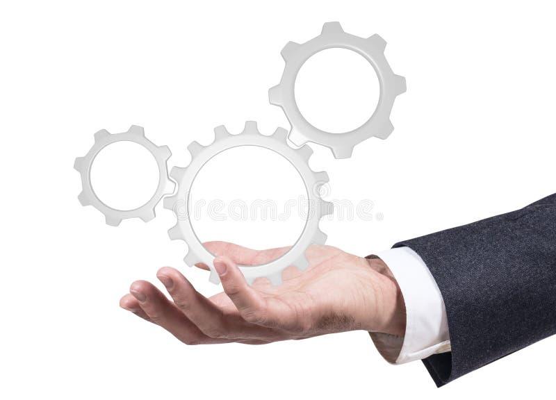 Mano del ` s del hombre de negocios que muestra la cooperación de los engranajes representación 3d imagenes de archivo