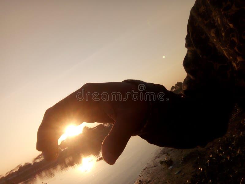 mano del sol fotografía de archivo libre de regalías
