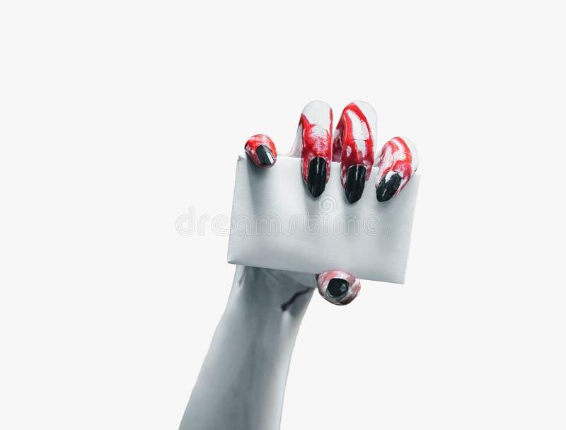 Mano del vampiro con la tarjeta vacía foto de archivo