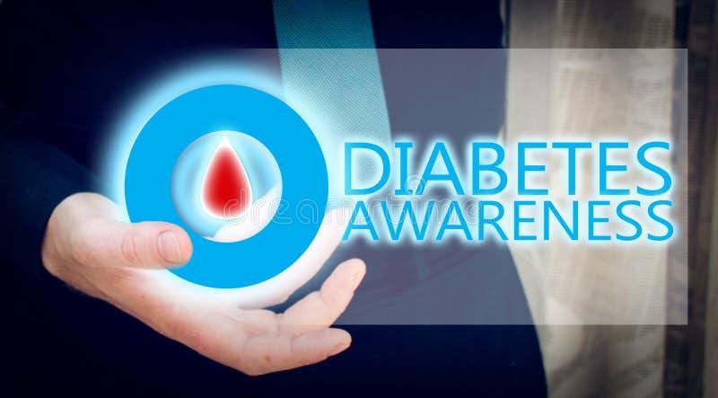 Mano dell'uomo che tiene cerchio blu con goccia del sangue, concetto di awarees del diabete immagini stock libere da diritti