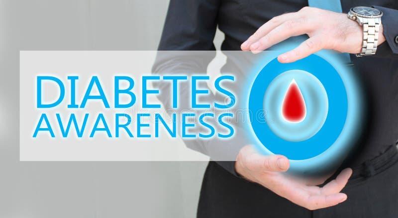 Mano dell'uomo che tiene cerchio blu con goccia del sangue, concetto di awarees del diabete immagine stock