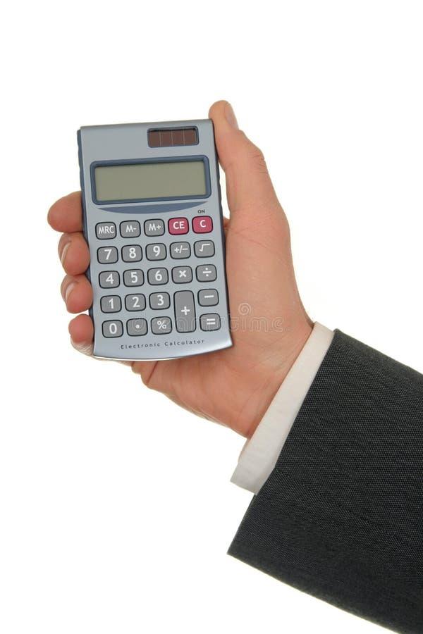 Mano dell'uomo d'affari che tiene un calcolatore immagini stock