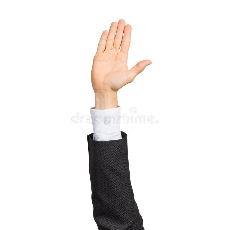 Mano dell'uomo d'affari in vestito che mostra gesto aperto della palma fotografie stock