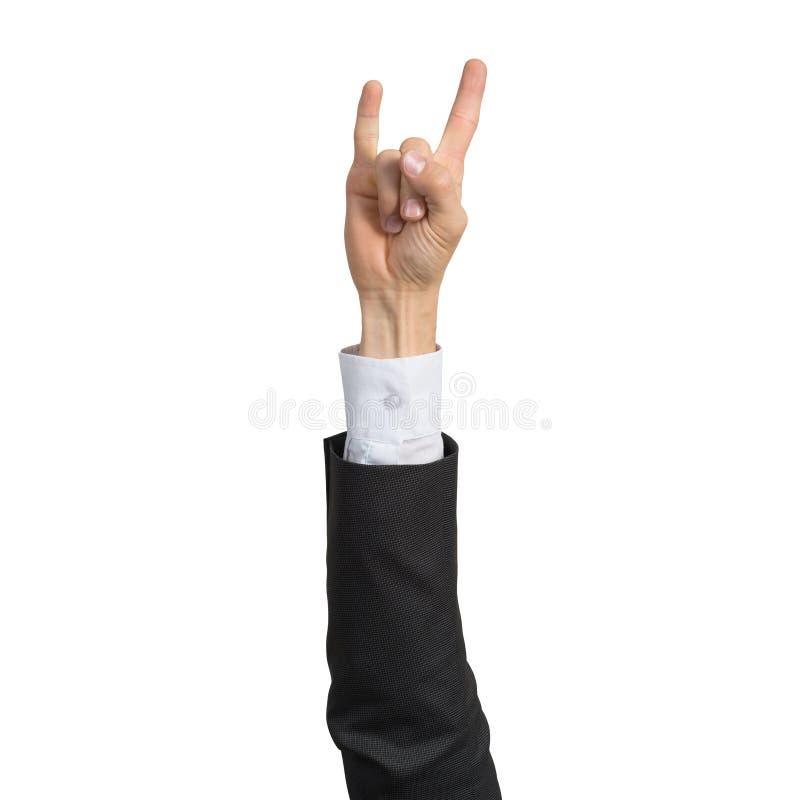 Mano dell'uomo d'affari in vestito che mostra gesto della roccia fotografie stock