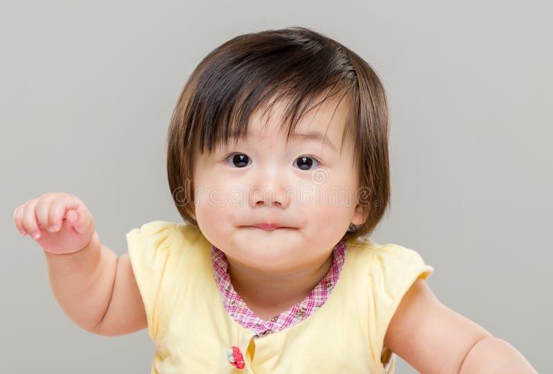 Mano della bambina su fotografie stock