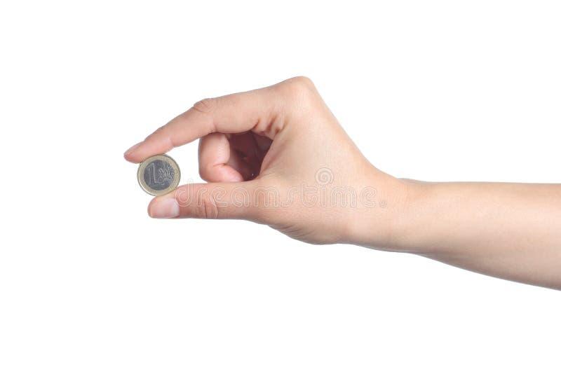 Mano della donna che mostra un'euro moneta immagini stock libere da diritti