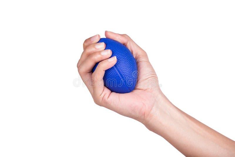 Mano della donna che schiaccia una palla di sforzo immagini stock libere da diritti