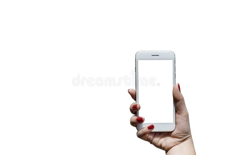 Mano della donna che tiene un telefono bianco E lo schermo bianco ha una b bianca fotografie stock