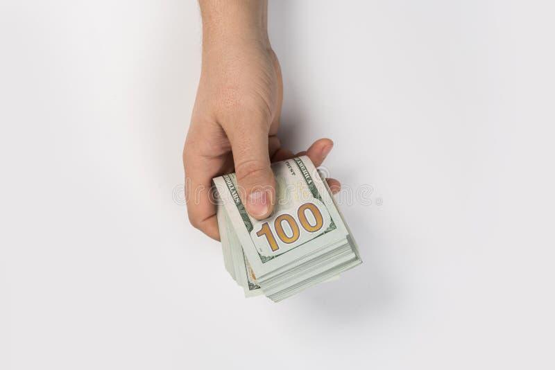 Mano della donna con i dollari isolati fotografie stock libere da diritti