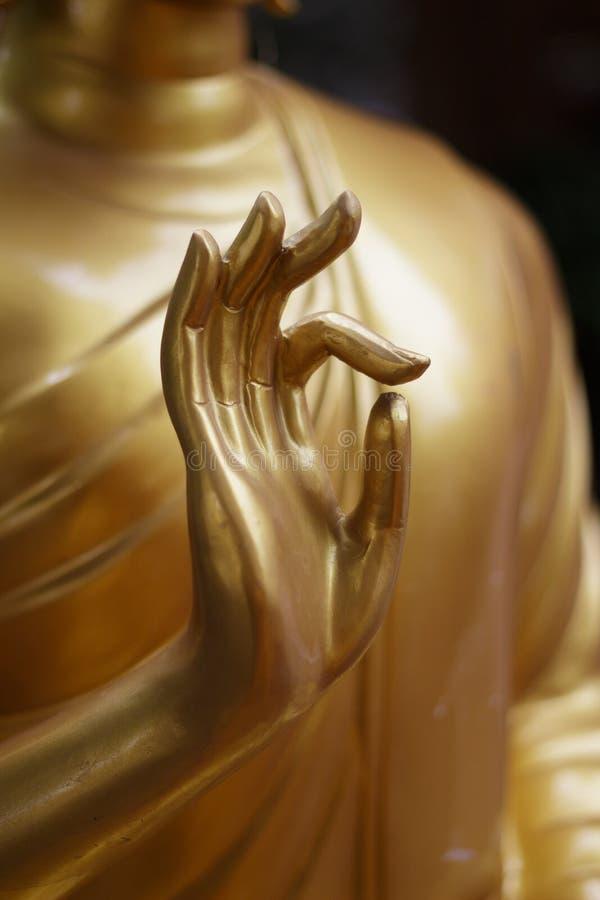 Mano della statua del Buddha immagine stock